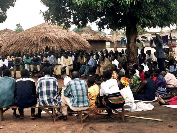 Meeting of people in village in uganda africa